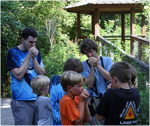 LABO volunteer, Eric Liffman, teaching local kids how to mimic Eastern Screech Owl calls at Bluebonnet Swamp. Photo by John Hartgerink.